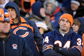 The gent's expression, in the Walter Payton jersey, sums up how Bear fans have felt watching this team not make the playoffs since 2010...