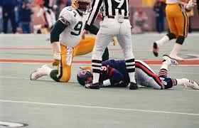 Charles Martin (94) would probably be suspended indefinitely for pulling a similar stunt in today's NFL. This late hit on Jim McMahon (riving in obvious pain on the turf) was one of the most blatant cheap shots ever seen in an NFL contest in recent memory...