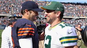 Only one of these guys should've been smiling after this game as Rodgers continued his dominance over Cutler's BEARS...