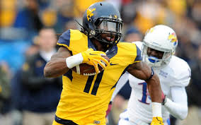 "West Virginia WR Kevin White has been described as Larry Fitzgerald with a little more speed and at 6'3"" 215 pounds he's soared up some team's draft boards even ahead of Alabama's Amari Cooper as the best WR available."